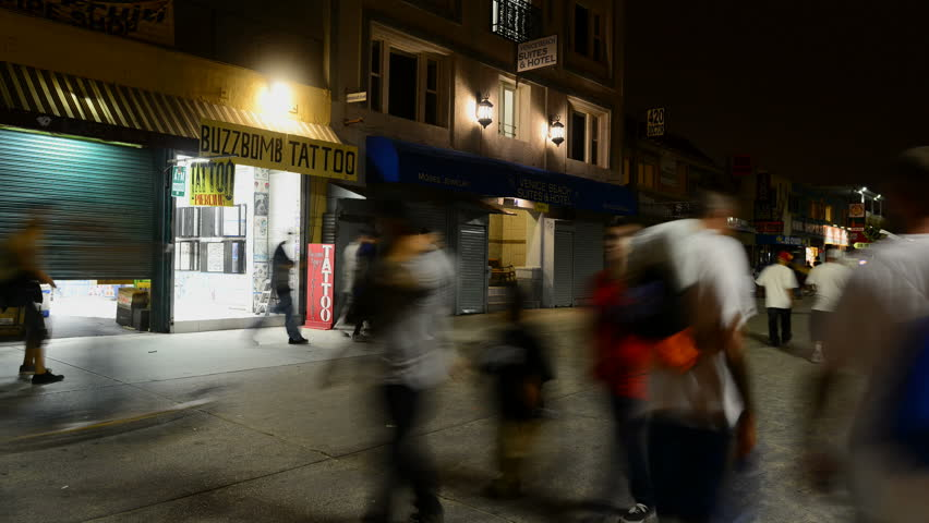 VENICE, CA - CIRCA OCT 2012: Time lapse of pedestrians walking along the Venice, California boardwalk circa October 2012.
