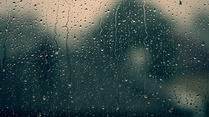 Rain days, heavy rain falling on window surface