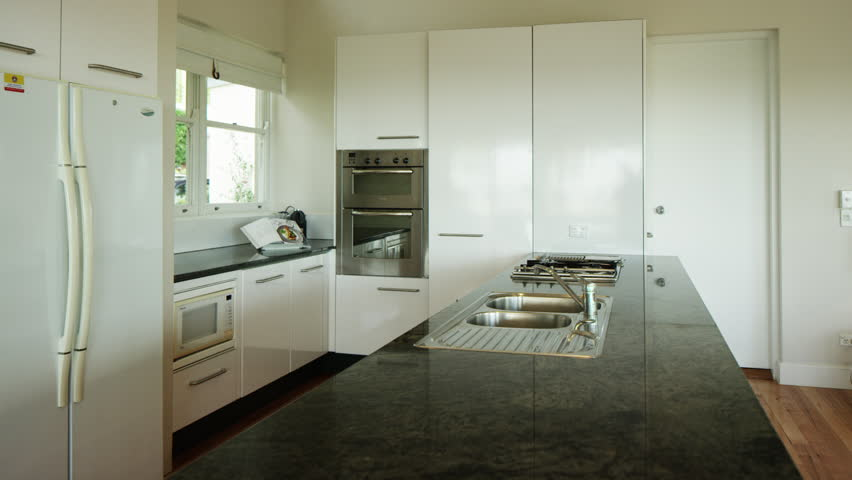 white kitchen with black bench top hd stock video clip - Rustic Modern Master Bathroom