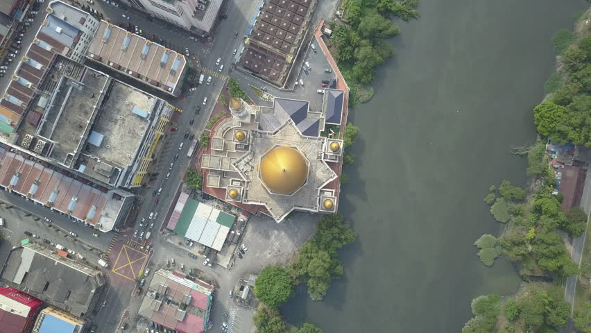 Malaysia, Circa 2017 - Aerial Footage - The Klang Town Royal Mosque, Selangor, Malaysia. The mosque is located at Jalan Pasar on the banks of the Klang River giving the image of a floating mosque