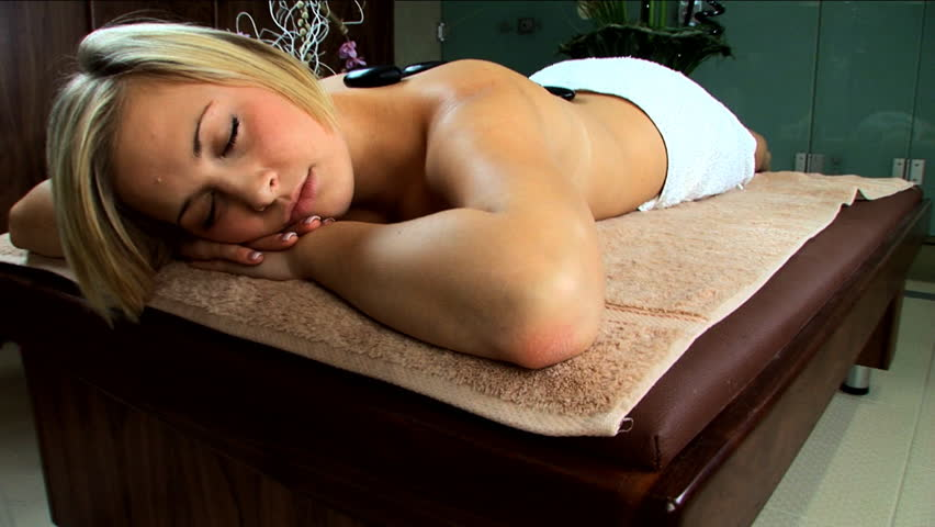 Beautiful blonde girl is pampered at the health spa