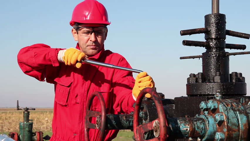 stock video of oil worker in action at oil