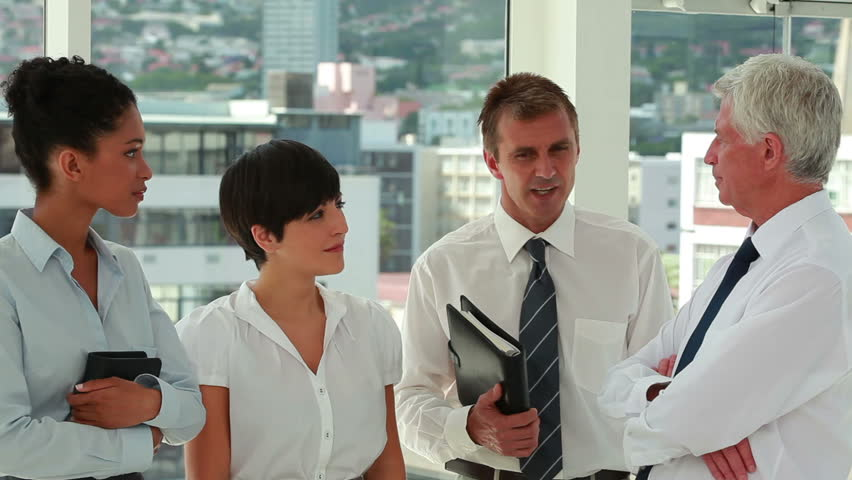Business people talking while standing in a bright room | Shutterstock HD Video #2982301