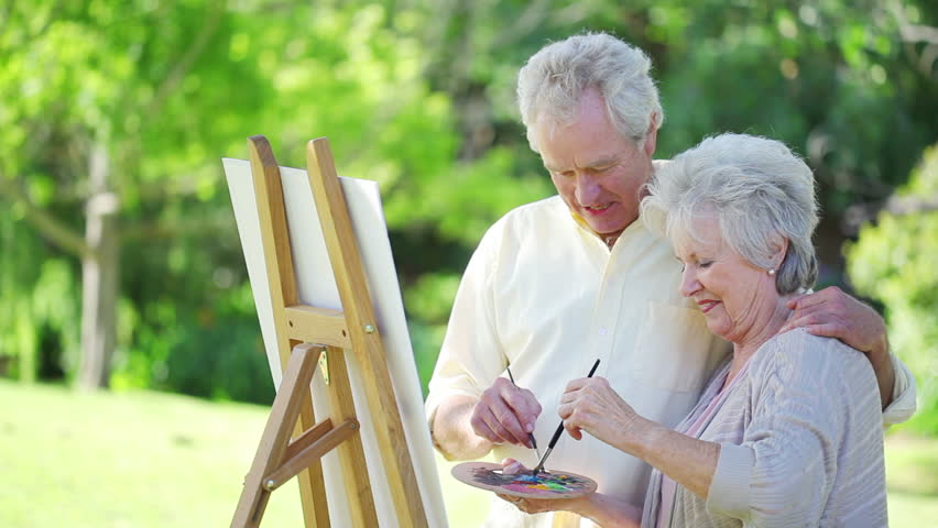 Hd0012Retired Couple Painting Together Outside