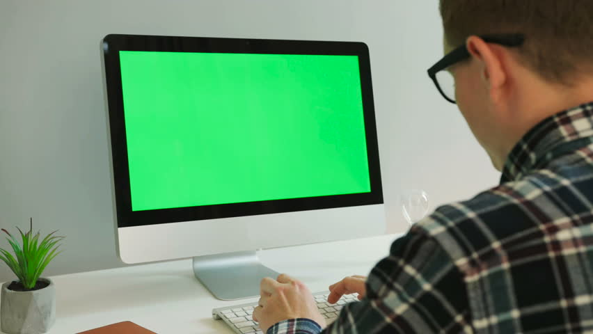 Portrait of business man with glasses using computer with green screen in the modern office. Chroma key. | Shutterstock HD Video #29845708