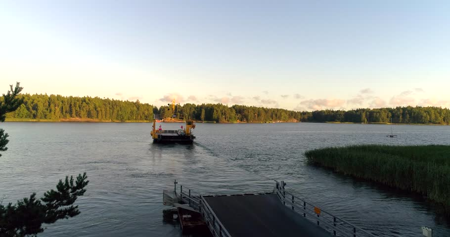 Car ferry, Cinema 4k aerial view following a cable ferry, in the finnish archipelago, on a sunny evening dawn, in Raasepori, Finland    Shutterstock HD Video #29847952