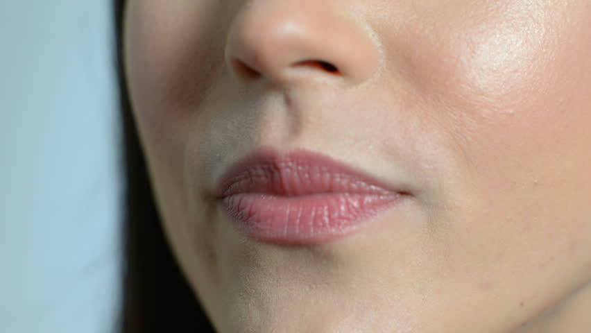 Close Up Of Beautiful Woman's Mouth With Perfect Teeth As She Speaks
