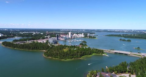 Keilaniemi, Cinema 4k aerial view towards kagelviken, keilalahti and route 51, just outside helsinki, at a sunny day, in Espoo, Uusimaa, Finland