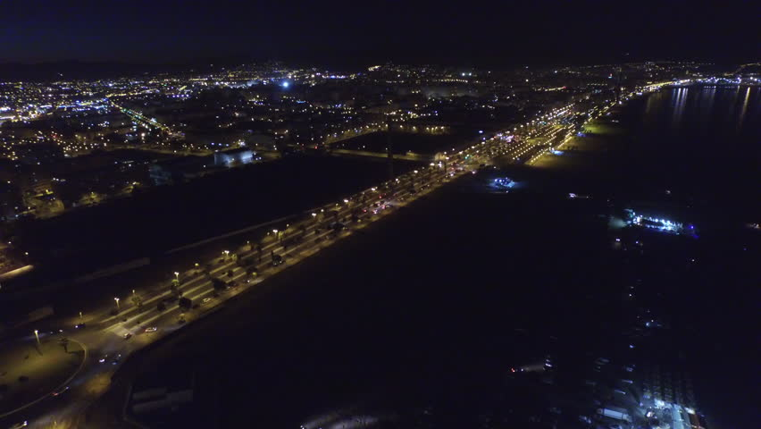 Aerial 180 pan of the nights sky in the south of the Spain part 2 of 3.  The city lights of Malaga, Spain are beautifully highlighted by the peaceful darkness of the sea. 4k 30fps august 11, 2015