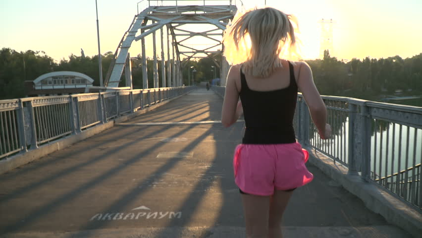Girl jogging on the bridge | Shutterstock HD Video #29897161