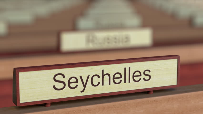 Seychelles name sign among different countries plaques at international organization. 3D rendering
