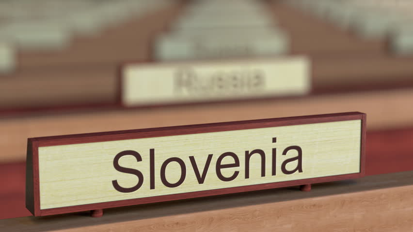 Slovenia name sign among different countries plaques at international organization. 3D rendering