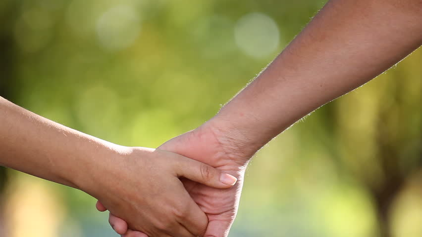 Two lovers separating their hands