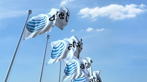 Waving flags with AT&T logo against sky, seamless loop. 4K editorial animation