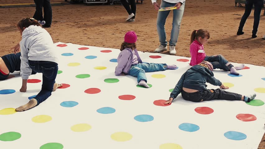 Little girls playing twister apologise, but