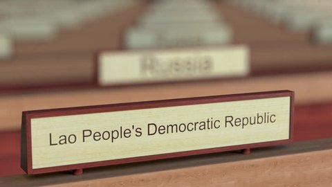 Laos name sign among different countries plaques at international organization. 3D rendering