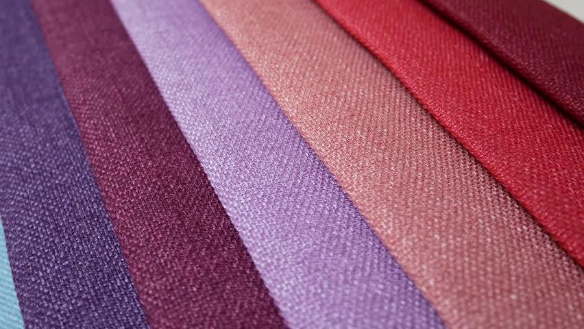 Fabric Samples Of Different Colors In Move Are Spinning And Rotation: Turquoise, Blue, Purple, Pink, Red. Textile Textures Fabric Swatches
