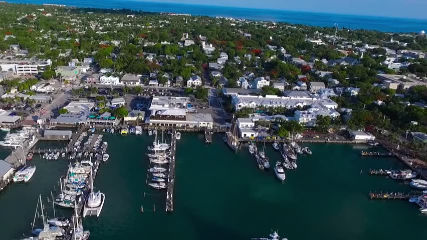 Big modern urban harbor bay for small luxury yacht motor boat ship in ocean Florida city aerial drone seascape skyline