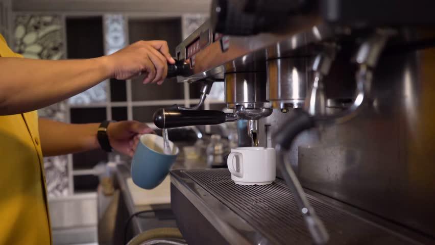 Close up of coffee machine at work