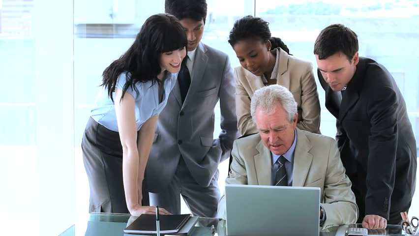 Businesswoman pointing at a laptop in a bright room | Shutterstock HD Video #3003046