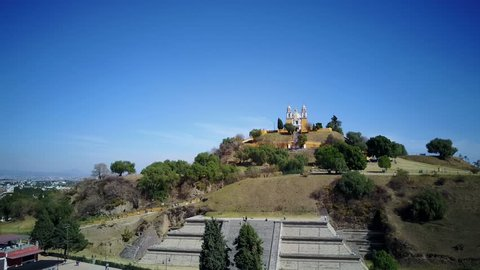4K Video of Afternoon flying up aerial view of the famous Pyramid of Cholula, Mexico