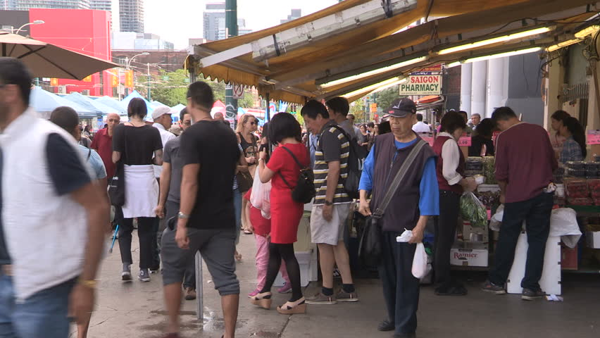 Toronto Ontario Canada August 2017 Chinatown Market District Crowded With People And Vendors