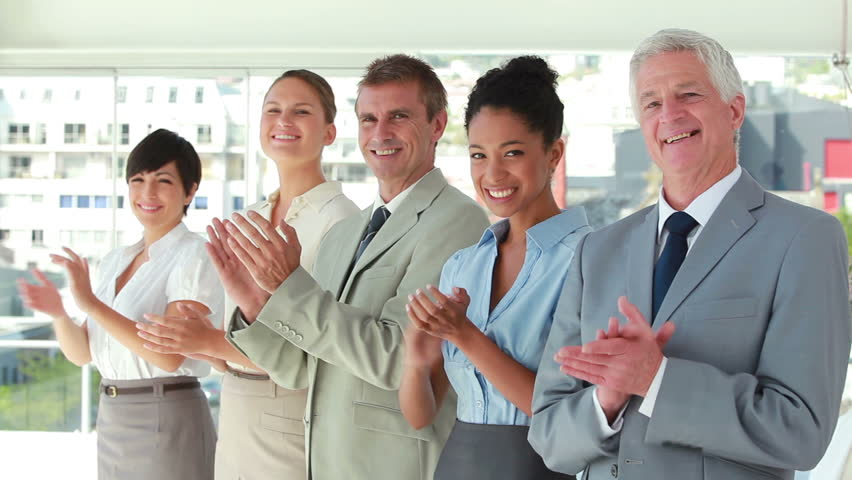 People in suit applauding in line in a bright room | Shutterstock HD Video #3008551
