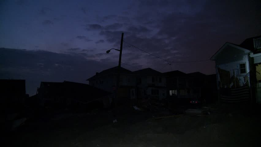 QUEENS, NY - NOVEMBER 11: Damaged houses without power at night in the Rockaway beach - Bel Harbor due to impact from Hurricane Sandy in Queens, New York, U.S., on November 11, 2012.