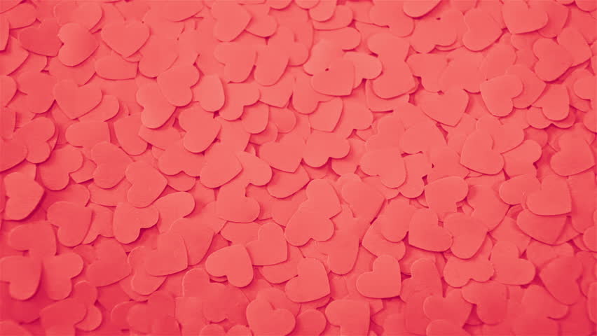 Romantic background with handmade paper hearts.