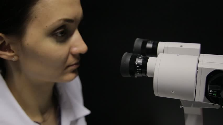 The doctor performs the eye examination of the patient using the newest technology | Shutterstock HD Video #30131917