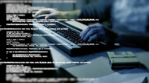 A flow of source code text program instructions in tilt-shift, overlayed on the hands of a man typing on a computer pc keyboard.