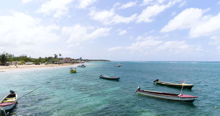 Aerial Drone Shot Over Exotic Caribbean Ocean Beach With Fishing Boats Jamaican Nature Landscape Summer Vacation Destination Tourism And Travel Concept Slow Motion 4k   Shutterstock HD Video #30134971