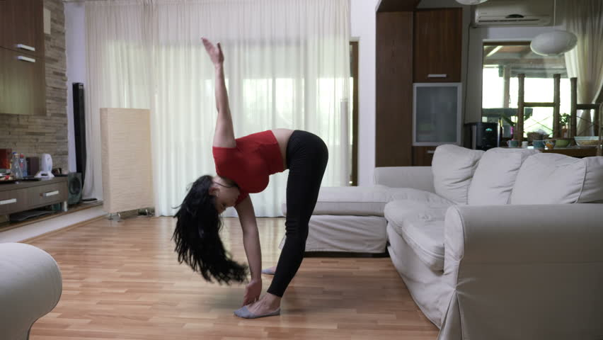 Young woman filming tutorial on how to exercise at home | Shutterstock HD Video #30154591