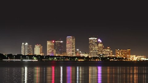Downtown Tampa, Florida skyline time lapse at night from across Hillsborough Bay.