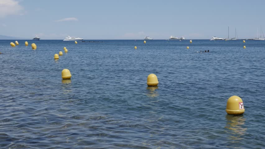 Yellow marker swim area buoys on water slow-mo 1920X1080 HD footage - Slow motion swimming zone border signs 1080p FullHD video
