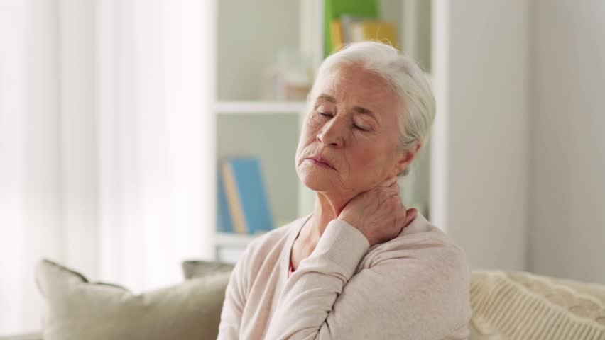 Old age, health problem and people concept - senior woman suffering from neck pain at home | Shutterstock HD Video #30208591