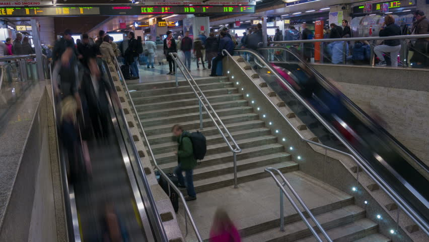 ROME - NOVEMBER 01: (TIME-LAPSE) Crowds of people using escalators at Rome's train station on November 01, 2012 in Rome, Italy. Roma Termini (Stazione Termini) is the main railway station of Rome.