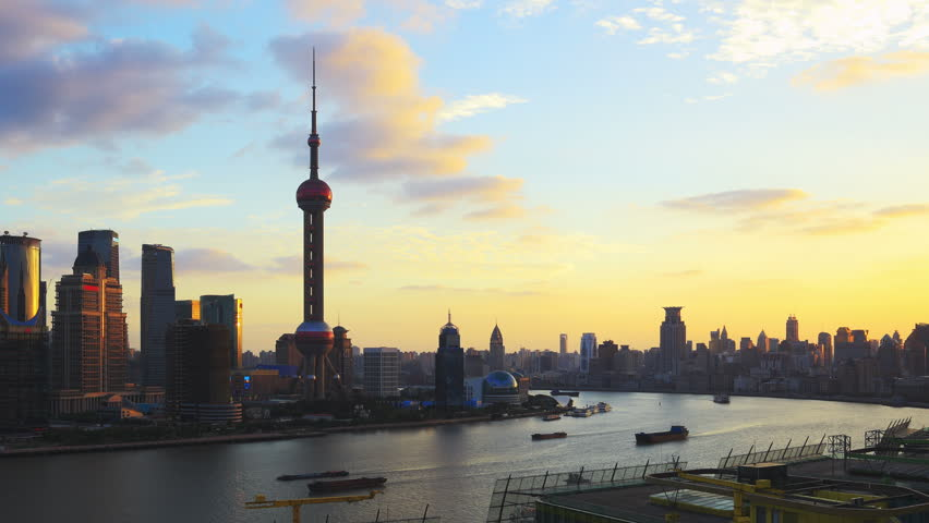 Shanghai skyline, panning timelapse. Shanghai skyscrapers and Huangpu river, China. On the left, Pudong with the Oriental Pearl Tower. On the right, The Bund (Puxi Waitan).