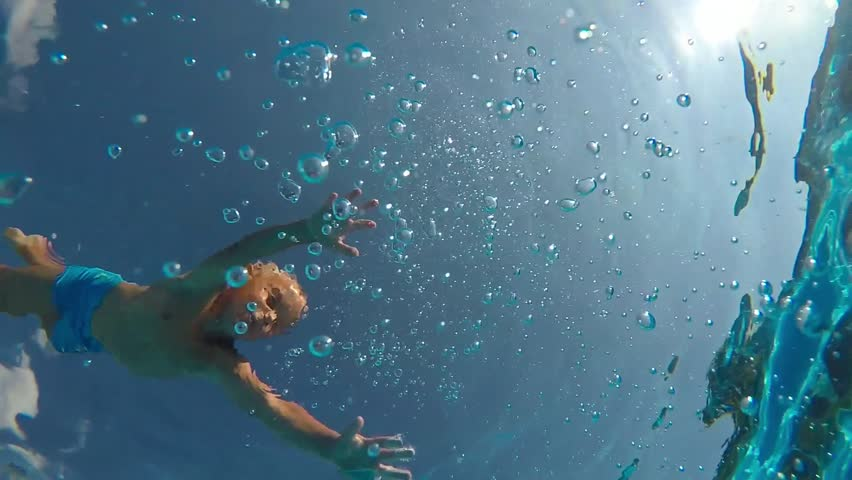 Jump into the water. Boy jumping into the water. Half underwater shot. Slow motion. | Shutterstock HD Video #30280831