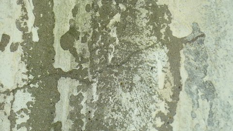 Cracked wall, cracked concrete, building demolition. A crack in the concrete wall increases