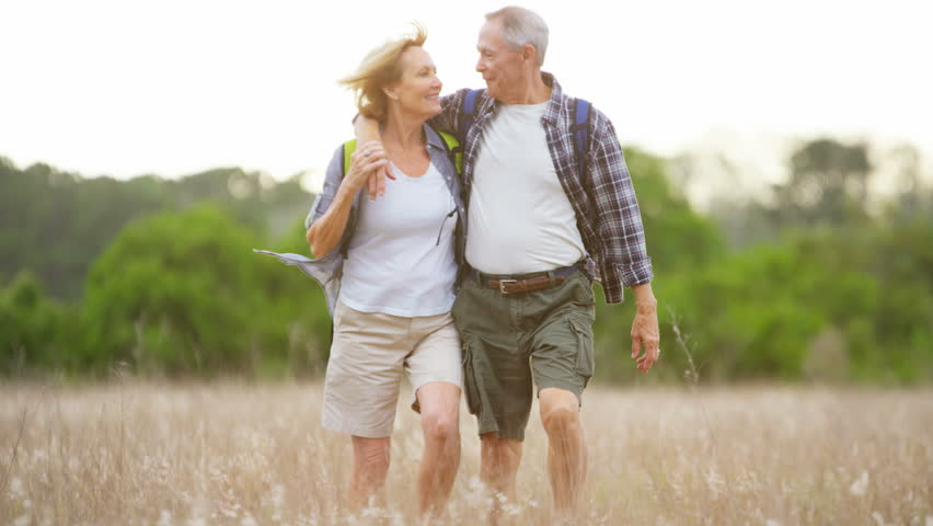 Carefree Caucasian American seniors enjoying their vacation hiking in the countryside outdoors RED DRAGON #30307081