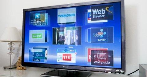 LONDON, UNITED KINGDOM - CIRCA 2017: Time-lapse fast motion of television screen of Panasonic TV Oled Viera plasma showcasing multiple apps for entertainment, news documentaries - netflix, bbc, etc