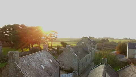"""Flying over the village and the chapel of """"Saint Colomban"""" at sunset, located in Carnac, Morbihan, Bretagne, France. Carnac is well-known for its famous rows of standing stones."""