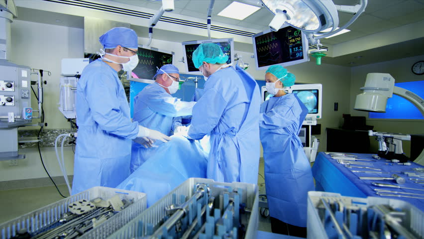 Caucasian medical healthcare hospital surgeons performing Orthopaedic operation in theatre using video monitors and modern technology RED WEAPON | Shutterstock HD Video #30344635
