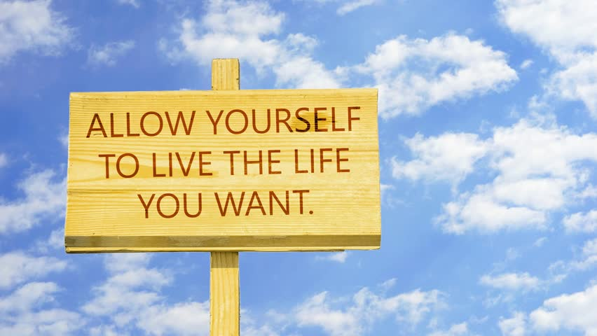 Allow Yourself To Live The Life You Want. Words On A Wooden Sign Against  Time