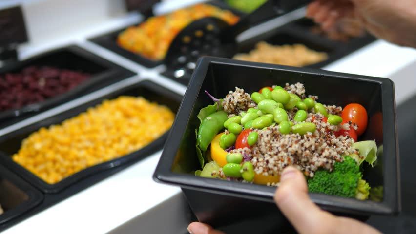 Healthy Food Fresh Vegetable Salad In Salad Bar. 4K. Closeup.