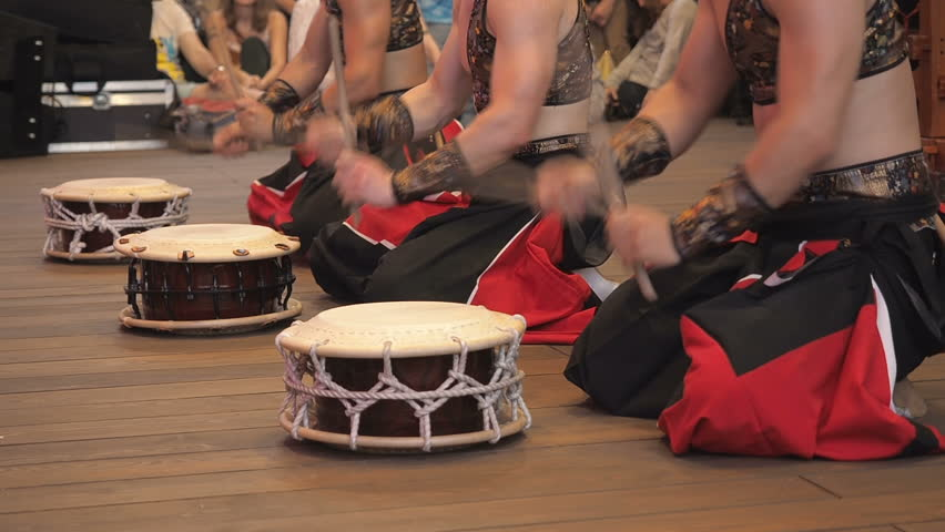 Musicians play the taiko shime-daiko drums on scene During the japanese festival.