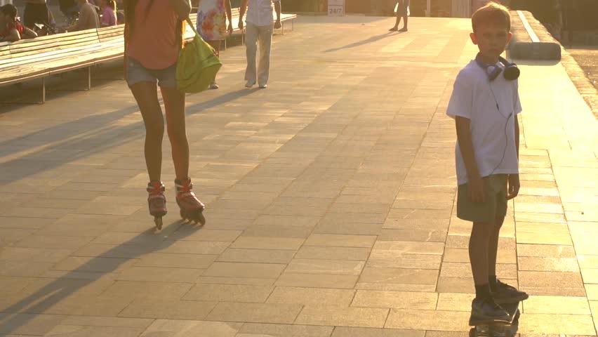 Skateboarding in the city park at sunset