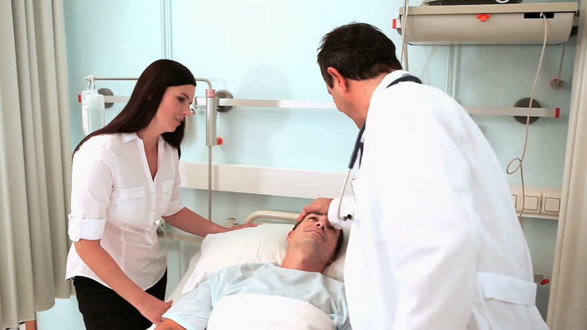Video of a doctor examining a patient with a stethoscope in hospital ward