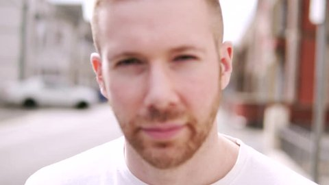Slow Motion Portrait Of Hipster Man With Beard on a Street. Short Hair Skinhead and White Caucasian.